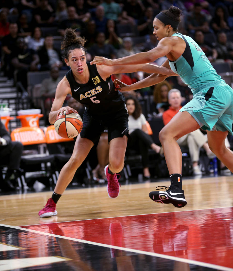 Las Vegas Aces forward Dearica Hamby (5) drives past New York Liberty center Kiah Stokes (41) in the second half of a WNBA basketball game at the Mandalay Bay Events Center in Las Vegas on Sunday, ...