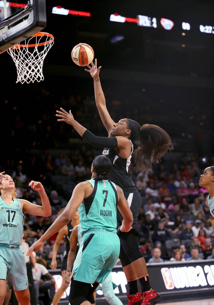 Las Vegas Aces center Kelsey Bone (3) shoots over New York Liberty center Amanda Zahui B. (17) and center Kia Vaughn (7) in the second half of a WNBA basketball game at the Mandalay Bay Events Cen ...