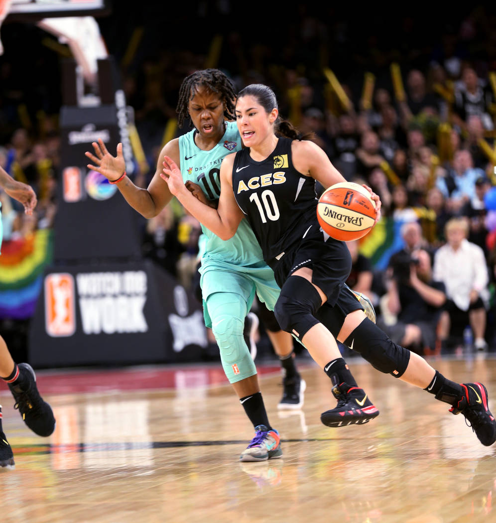Las Vegas Aces guard Kelsey Plum (10) drives past New York Liberty guard Epiphanny Prince (10) in the second half of a WNBA basketball game at the Mandalay Bay Events Center in Las Vegas on Sunday ...