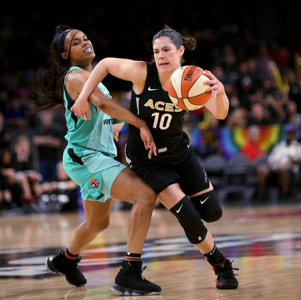 Las Vegas Aces guard Kelsey Plum (10) drives past New York Liberty guard Brittany Boyd (15) in the second half of a WNBA basketball game at the Mandalay Bay Events Center in Las Vegas on Sunday, J ...