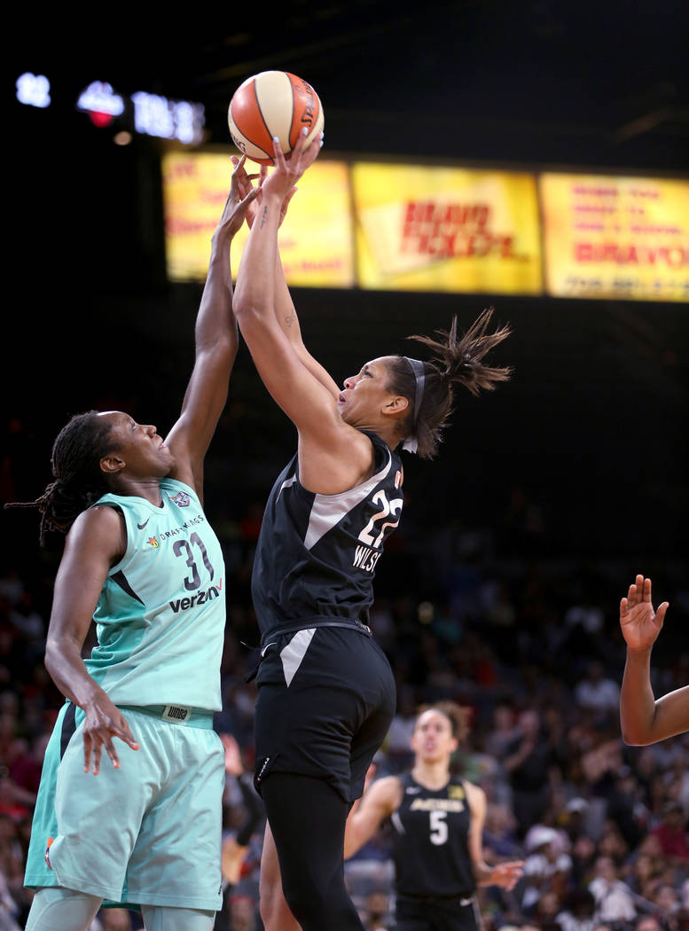 Las Vegas Aces center A'ja Wilson (22) shoots over New York Liberty center Tina Charles (31) in the second half of a WNBA basketball game at the Mandalay Bay Events Center in Las Vegas on Sunday, ...