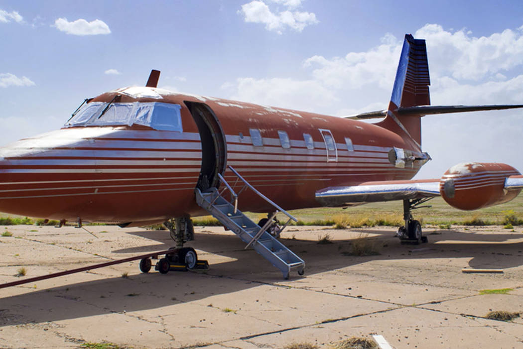A private jet once owned by Elvis Presley is seen parked on a runway in New Mexico. (GWS Auctions, Inc. via AP)