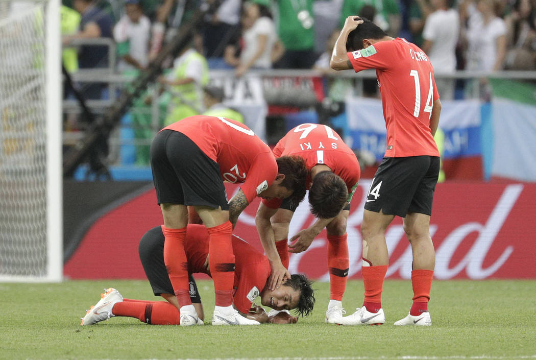 South Korea players are dejected at the end of the group F match between Mexico and South Korea at the 2018 soccer World Cup in the Rostov Arena in Rostov-on-Don, Russia, Saturday, June 23, 2018. ...