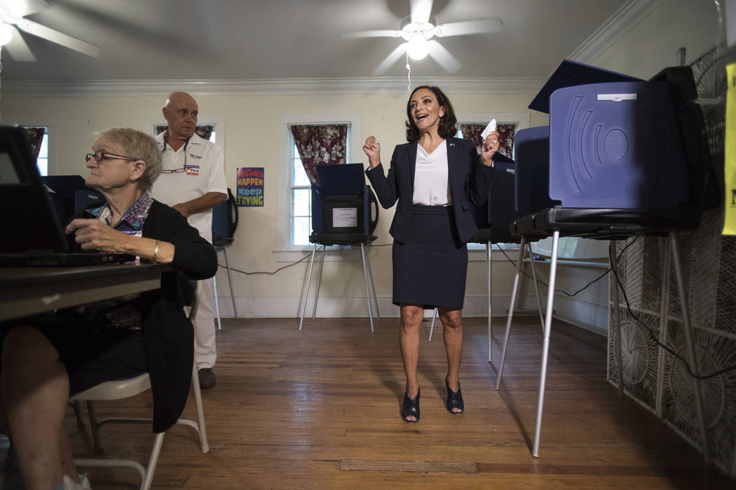 South Carolina Rep. Katie Arrington, who is running for the first district of South Carolina, celebrates after casting her vote at Bethany United Methodist Church in Summerville on June 12. Arrin ...