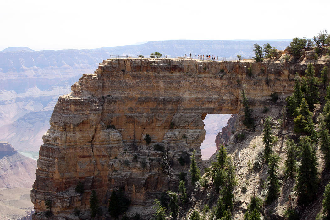 Hikers stand above Angels Window just a five minute hike from Cape Royal Road at the North Rim of the Grand Canyon in Arizona. (Deborah Wall/Las Vegas Review-Journal)