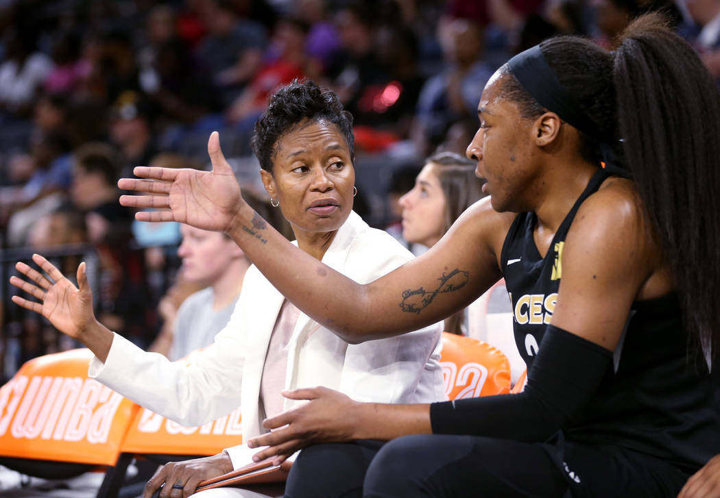 Las Vegas Aces assistant coach Vickie Johnson talks toAces center Kelsey Bone (3) during a WNBA basketball game against the New York Liberty at the Mandalay Bay Events Center in Las Vegas Su ...