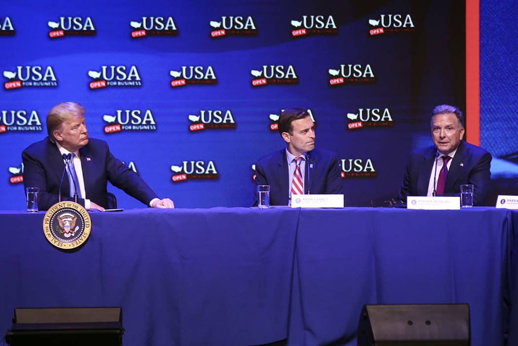 President Donald Trump, left, listens to Steven Witkoff, Chairman and CEO of the Witkoff Group, during a roundtable discussion on tax cuts at the South Point in Las Vegas on Saturday, June 23, 201 ...