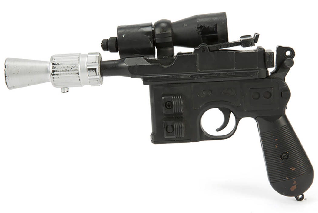 "This photo provided by Julien's Auctions shows character Han Solo's BlasTech DL-44 blaster from the Star Wars trilogy film ""Return of the Jedi"" (Lucasfilm, 1983) that sold for $550,000 at Julien's ..."