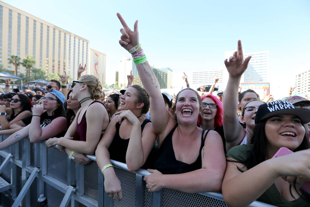 Fans, including Jess Roberts, of Boulder, Colo., second from right, watch Mayday Parade during Warped Tour at Downtown Las Vegas Events Center on Friday, June 29, 2018. K.M. Cannon Las Vegas Revie ...