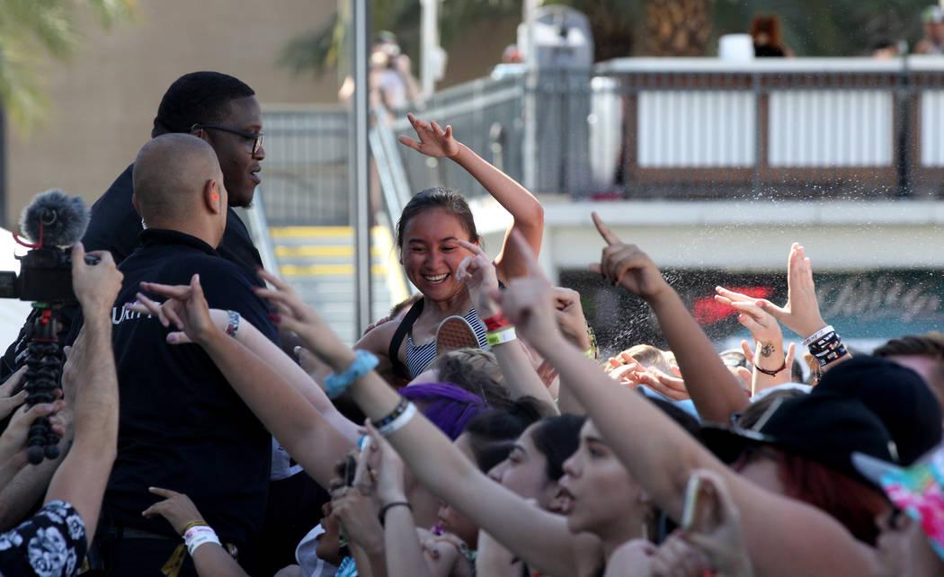 A fan crowd surfs during Warped Tour at Downtown Las Vegas Events Center on Friday, June 29, 2018. K.M. Cannon Las Vegas Review-Journal @KMCannonPhoto