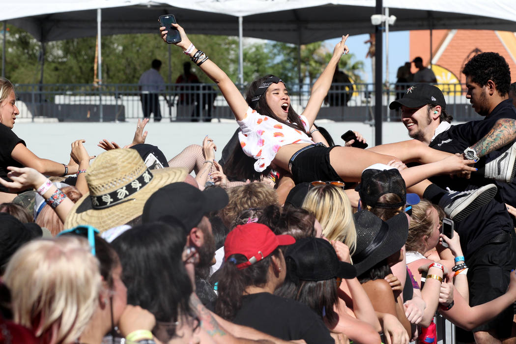 Fans cheer and crowd surf as Real Friends performs during Warped Tour at Downtown Las Vegas Events Center on Friday, June 29, 2018. K.M. Cannon Las Vegas Review-Journal @KMCannonPhoto