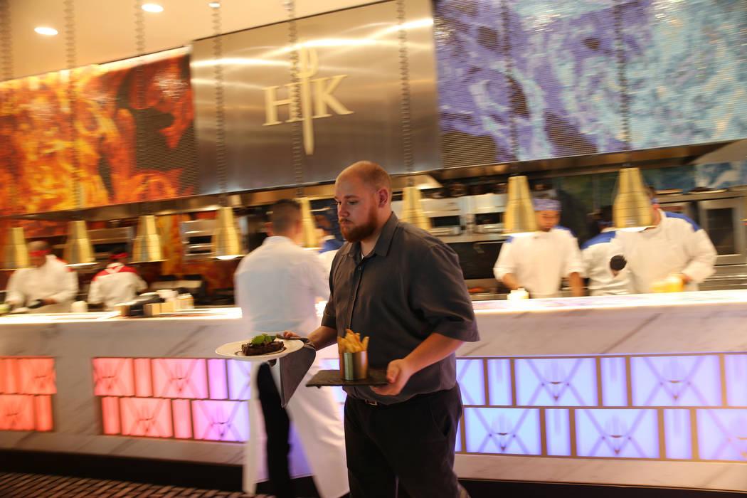 Food server Victor Gaitano delivers food to customers at Gordon Ramsay Hell's Kitchen in Las Vegas, Tuesday, July 17, 2018. Erik Verduzco Las Vegas Review-Journal @Erik_Verduzco
