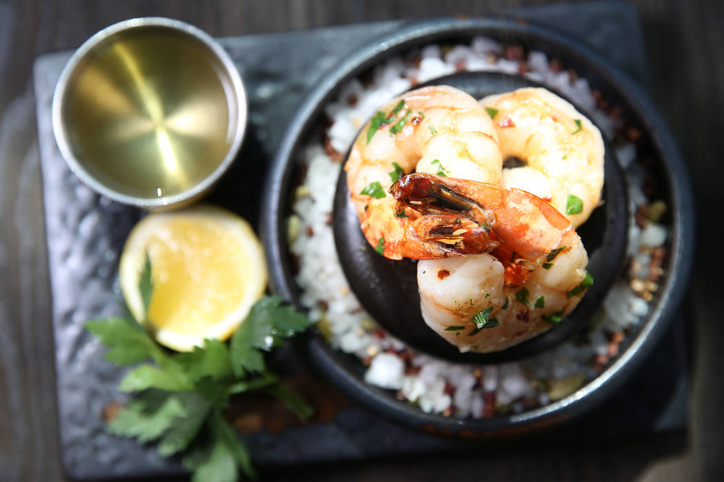 The scampi prawn flambe is served with garlic white wine sauce and drawn butter, at Gordon Ramsay Hell's Kitchen in Las Vegas, Tuesday, July 17, 2018. Erik Verduzco Las Vegas Review-Journal @Erik_ ...