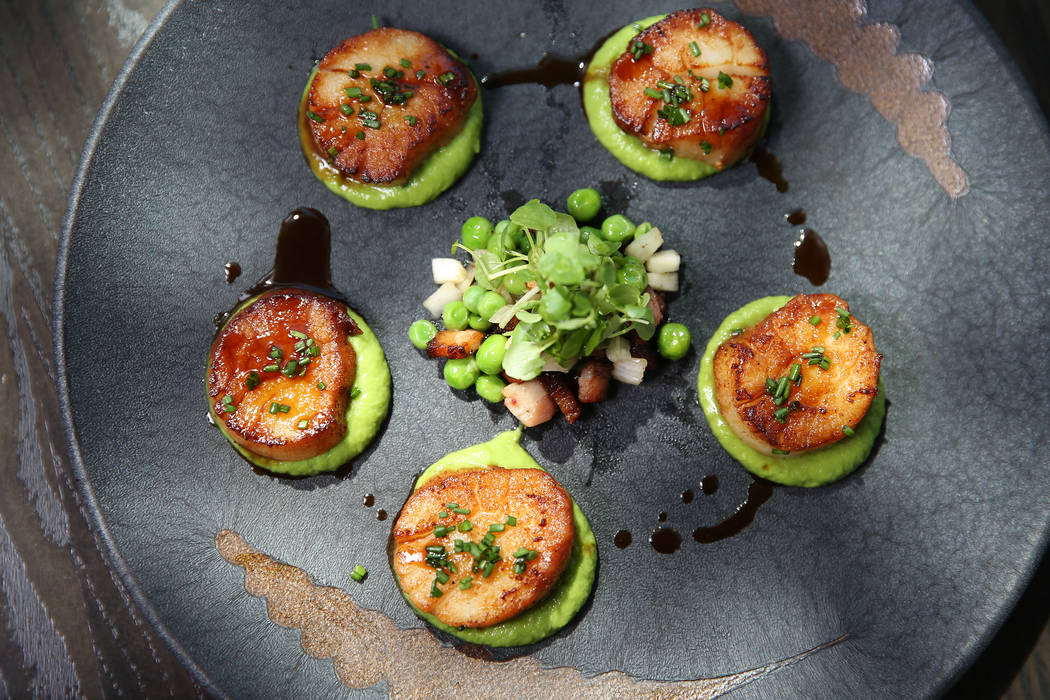 Pan seared scallops served with english pea puree, braised bacon lardons and pickled fennel, at Gordon Ramsay Hell's Kitchen in Las Vegas, Tuesday, July 17, 2018. Erik Verduzco Las Vegas Review-Jo ...