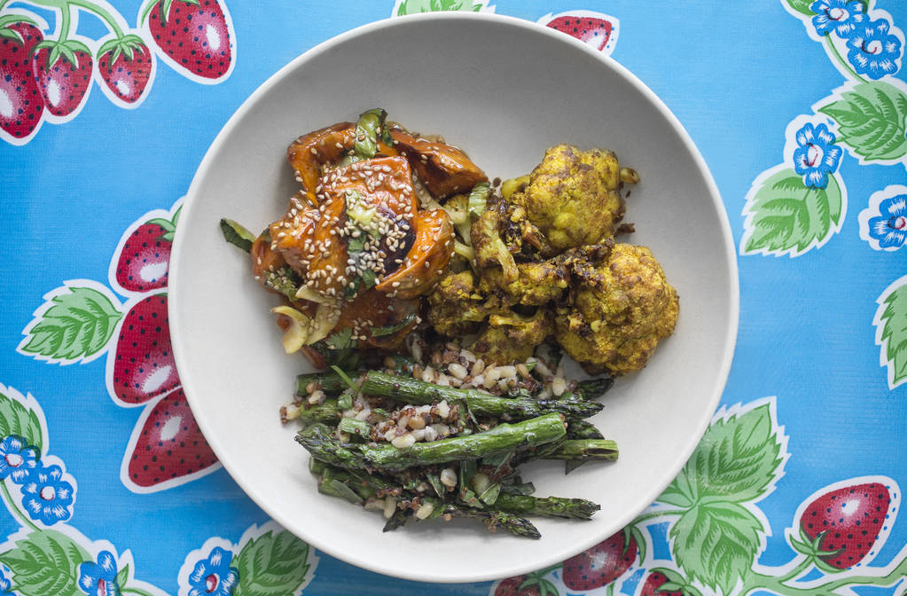 Red chili glazed sweet potato with bak choy sesame seed, indian spiced cauliflower with turmeric, date and almond and grilled asparagus with ancient grains and ginger miso at Flower Child on Frida ...