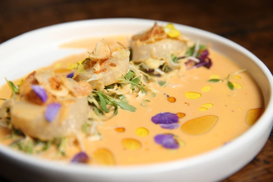 The scallop sashimi is served with sesame-uni leche de tigre and crispy onion, at Once restaurant at the Palazzo hotel-casino in Las Vegas, Wednesday, Aug. 1, 2018. Erik Verduzco Las Vegas Review- ...