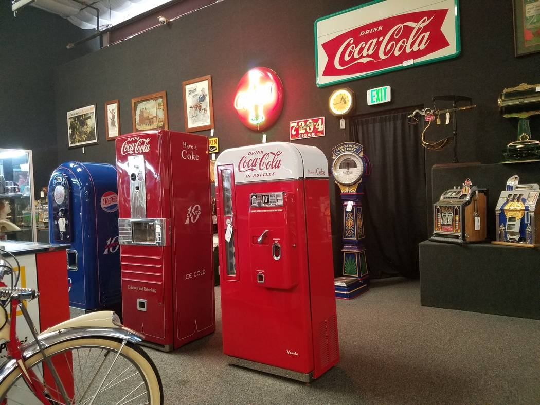Several different types of coin-operated machines, including these antique beverage machines were sold at auction by Dan Morphy of Morphy Auctions at a two-day coin-op and advertising auction in L ...