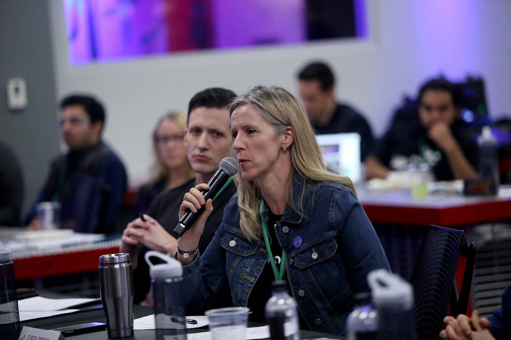 Ciara Byrne, co-founder and CEO of Green our Planet, asks a question of the presenter at the 2018 Techstars Startup Weekend at Rob Roy's Innevation Center in Las Vegas, Sunday, Nov. 18, 2018. With ...