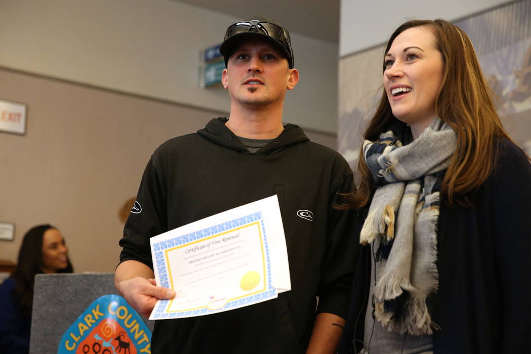 Jared Duval, left, and his wife Brooke Siegert, of Still Water, Minn., are interviewed after receving their wedding vow renewal certificate at the Marriage License Bureau in Las Vegas, Thursday, J ...
