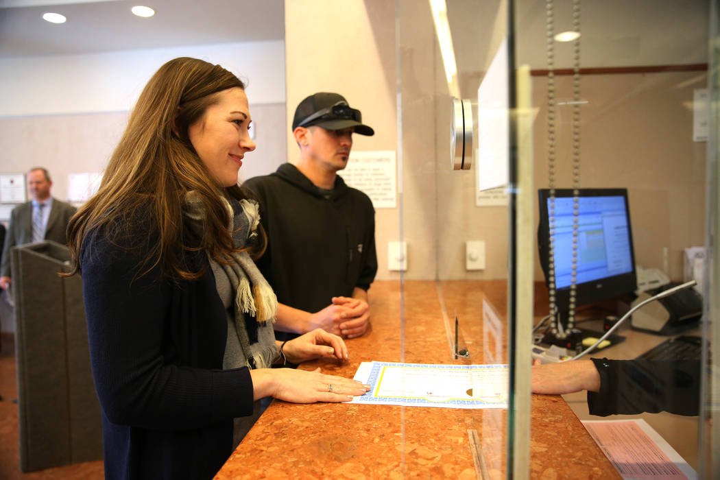 Jared Duval, right, and his wife Brooke Siegert, of Still Water, Minn., apply for their wedding vow renewal certificate at the Marriage License Bureau in Las Vegas, Thursday, Jan. 3, 2019. Duval a ...