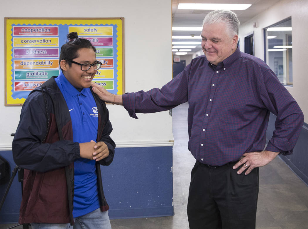 Boys & Girls Clubs ambassador Jose De Dios, left, shares a laugh with governor-elect Steve Sisolak during a visit to the Boys & Girls Clubs of Southern Nevada on Thursday, Jan. 3, 2019, in ...
