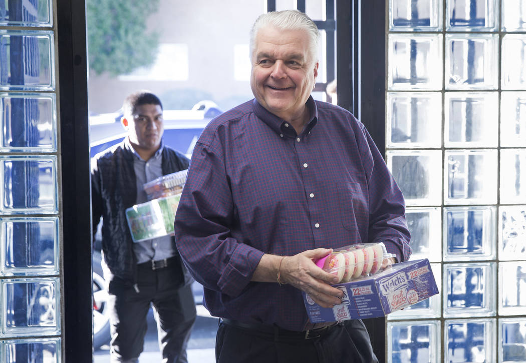 Governor-elect Steve Sisolak walks into the Boys & Girls Clubs of Southern Nevada with cupcakes during a tour of the facility on Thursday, Jan. 3, 2019, in Las Vegas. Benjamin Hager Las Vegas ...