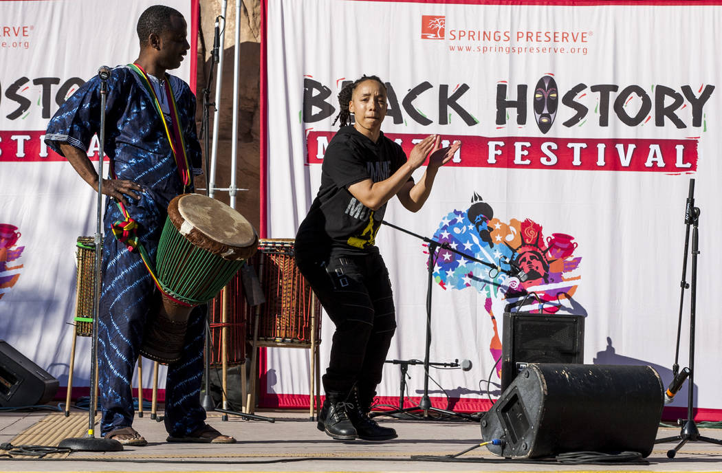 Drummer Samuel J. Wright watches as Angie Freeman of the performance group Molodi performs during a celebration of Black History Month at the Springs Preserve on Saturday, Feb. 17, 2018. Patrick ...