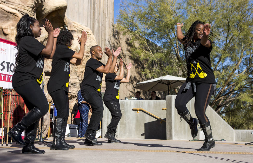Cammie Griffin, right, a member of Molodi, a performance ensemble,twirls while other performers, from left, Danielle Hicks, Kishema Pendu Malik, Jason Nious and Angie Freeman, stomp and clap ...