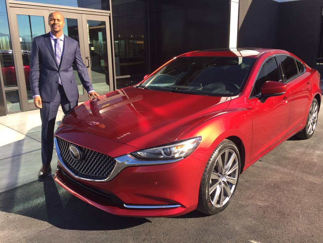 Findlay Mazda General Manager Allen Montalvo is seen with a 2018 Mazda6 model at the new dealership situated at 7760 Eastgate Road in the Valley Automall. (Findlay)
