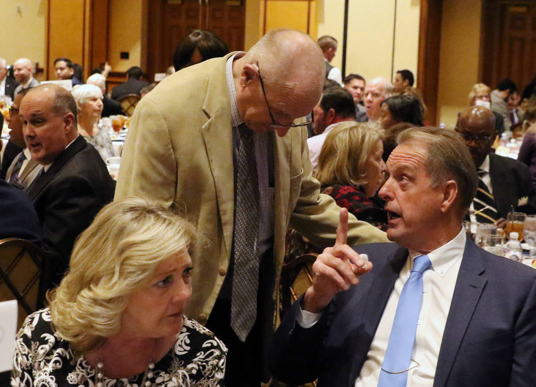 North Las Vegas Mayor John Lee, right, chats with Nevada State Sen. Joe Hardy, center, prior to delivering the 23rd annual State of the City address at the Texas Station on Tuesday, Jan, 29, 2019, ...