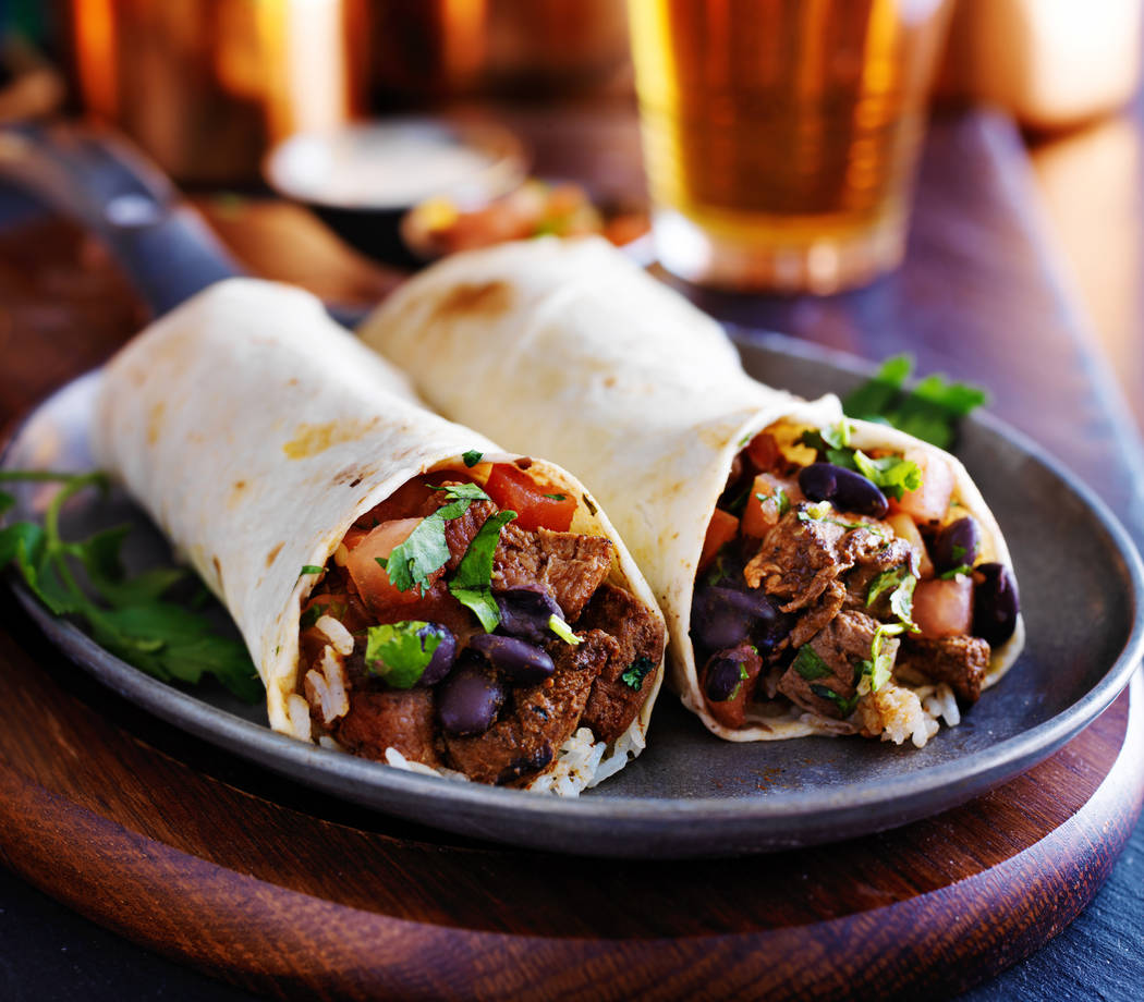 Getty Images two beef burritos with rice, black beans and salsa