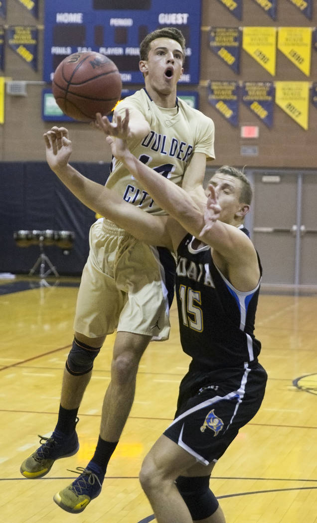 Boulder City senior guard Karson Bailey (14) drives past Moapa Valley senior forward Jessup Lake (15) in the first quarter on Tuesday, Jan. 29, 2019, at Boulder City High School, in Las Vegas. (Be ...