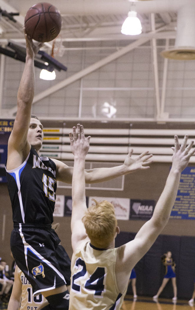 Moapa Valley senior forward Jessup Lake (15) shoots over Boulder City sophomore guard Matt Morton (24) in the second quarter on Tuesday, Jan. 29, 2019, at Boulder City High School, in Las Vegas. ( ...