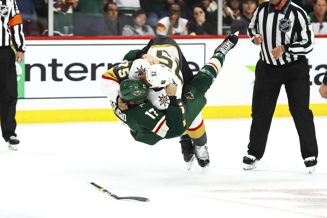 ST. PAUL, MN - OCTOBER 06: Minnesota Wild left wing Marcus Foligno (17), bottom, and Vegas Golden Knights right wing Ryan Reaves (75) fall to the ice while fighting during the regular season game ...
