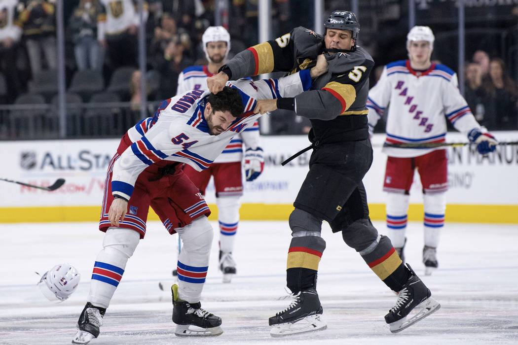 Vegas Golden Knights right wing Ryan Reaves, right front, and New York Rangers defenseman Adam McQuaid fight during the third period of an NHL hockey game Tuesday, Jan. 8, 2019, in Las Vegas. (AP ...