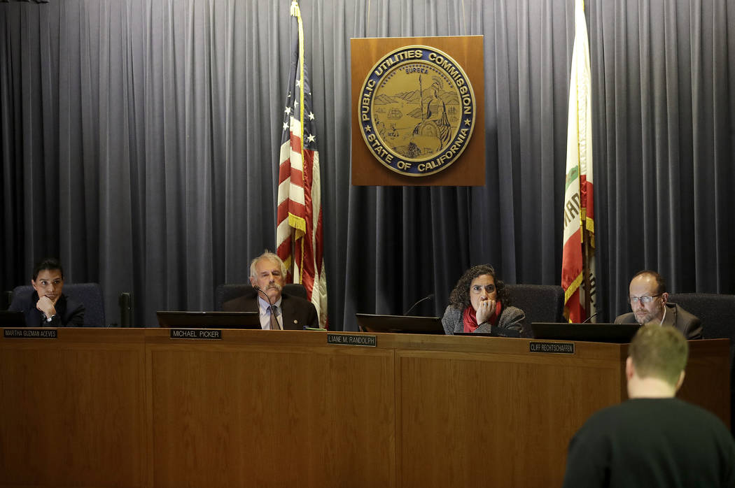 Michael Picker, President of the California Public Utilities Commission, second from left, listens to public comments with commissioners Martha Guzman Aceves, from left, Liane M. Randolph and Clif ...