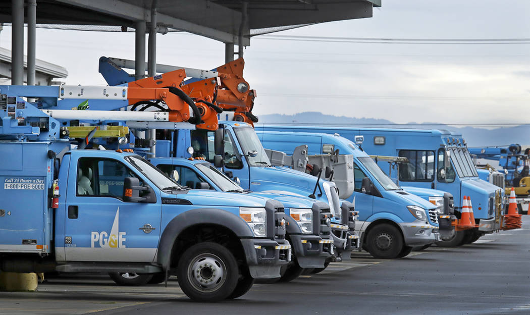 FILE - This Jan. 14, 2019 file photo shows Pacific Gas & Electric vehicles parked at the PG&E Oakland Service Center in Oakland, Calif. PG&E is expected to file for bankruptcy protecti ...