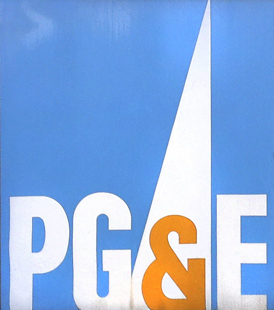 FILE - This Jan. 23, 2019 file photo shows the Pacific Gas & Electric Corp. logo on a sign at their customer center in Hayward, Calif. PG&E is expected to file for bankruptcy protection Tu ...