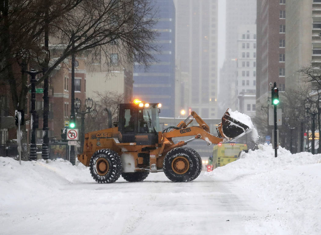 A plow removes snow along West Wisconsin Avenue at North 8th Street in Milwaukee on Monday, Jan. 28, 2019. Heavy snow and gusting winds created blizzard-like conditions Monday across parts of the ...