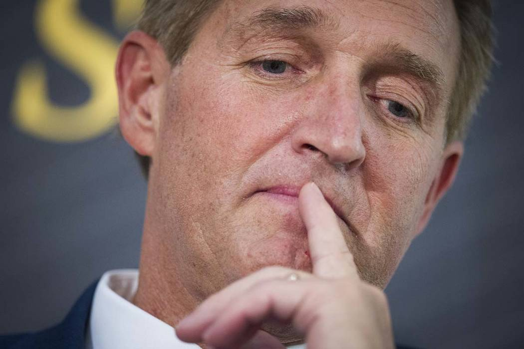 In this Oct. 2, 2018 file photo Sen. Jeff Flake, R-Ariz. participates in a forum in Washington. Flake says he hopes a Republican will challenge President Donald Trump's re-election bid, but it w ...