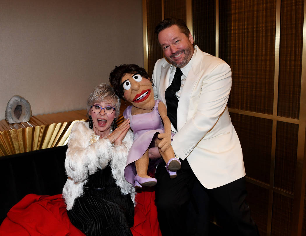 Rita Moreno poses with a puppet made in her likeness by Terry Fator at the Nevada Ballet's 35th Annual Black And White Ball at Aria on Jan. 26, 2019, in Las Vegas. (Denise Truscello/WireImage)