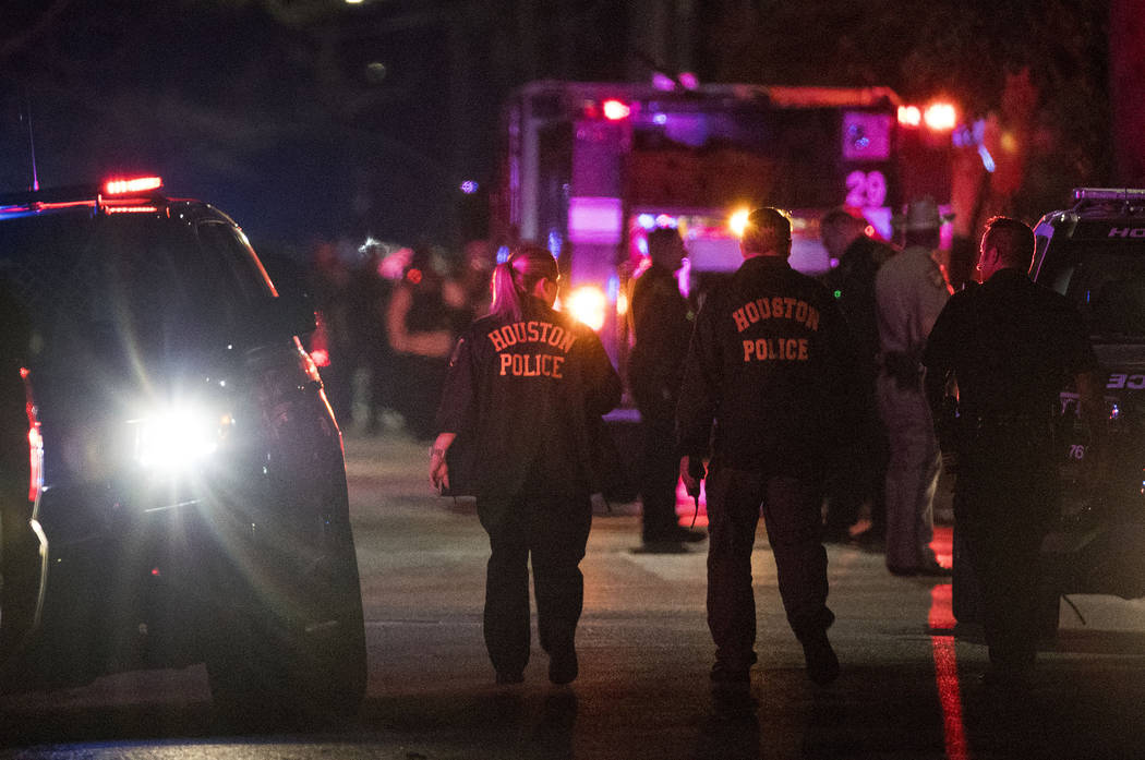 Police investigate the scene where several Houston Police officers were shot in Houston on Monday, Jan. 28, 2019. At least five Houston officers were injured in a shooting Monday in an incident in ...
