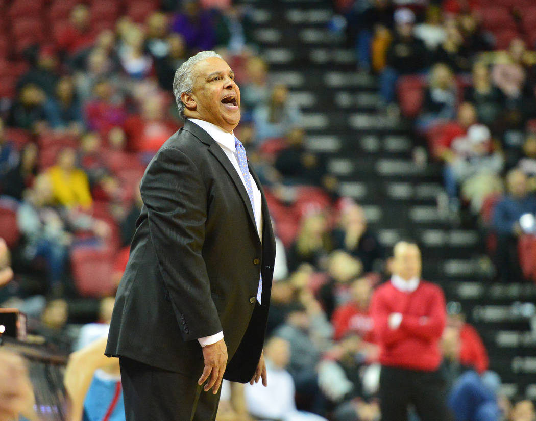 UNLV Rebels head coach Marvin Menzies shouts to his team during the second half of the UNLV Rebels and the New Mexico Lobos NCAA basketball game at the Thomas & Mack Center in Las Vegas on Tue ...