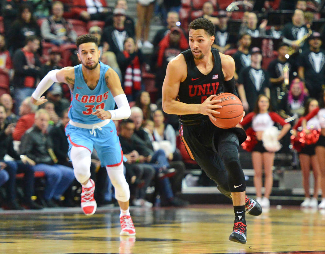 UNLV Rebels guard Noah Robotham (5) dribbles the ball on a breakaway during the first half of the UNLV Rebels and the New Mexico Lobos NCAA basketball game at the Thomas & Mack Center in Las V ...