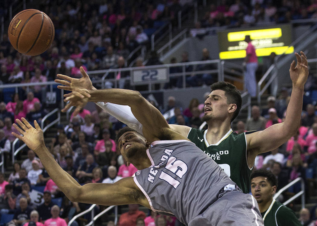UNR forward Trey Porter (15) and Colorado State center Nico Carvacho (32) fight for a rebound in the first half of an NCAA college basketball game in Reno, Nev., Wednesday, Jan. 23, 2019. (AP Phot ...
