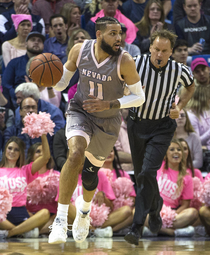 UNR forward Cody Martin (11) brings the ball up the court against Colorado State in the first half of an NCAA college basketball game in Reno, Nev., Wednesday, Jan. 23, 2019. (AP Photo/Tom R. Smedes)