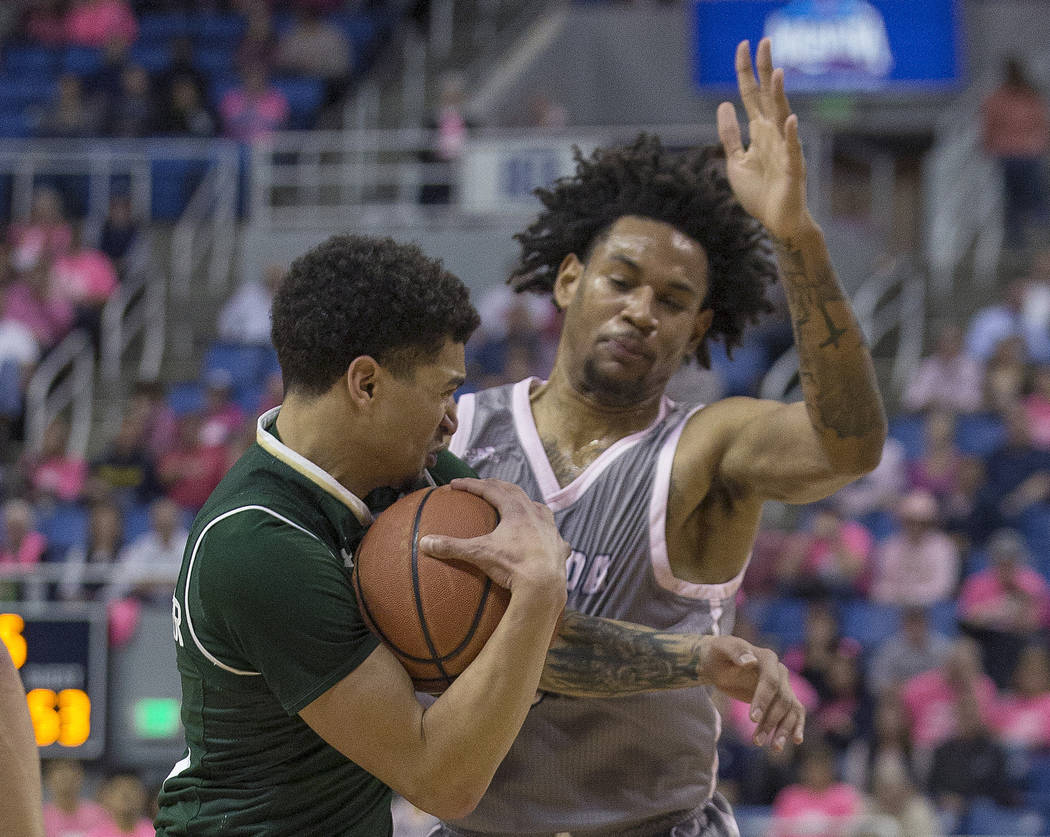 Colorado State forward Anthony Masinton-Bonner, left, runs into UNR guard Nisre Zouzoua in the second half of an NCAA college basketball game in Reno, Nev., Wednesday, Jan. 23, 2019. (AP Photo/Tom ...