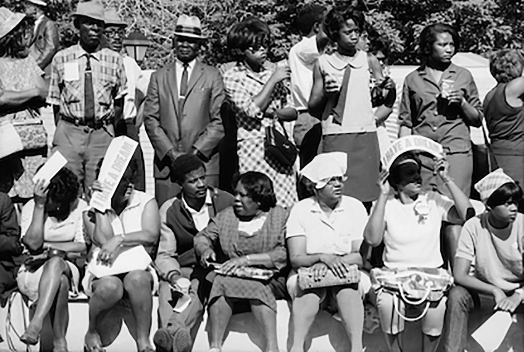 Viewers in Mississippi await marchers heading to the nation's capital in the 1968 Poor People's Campaign. Planning this campaign for economic justice was Martin Luther King Jr.'s final proje ...