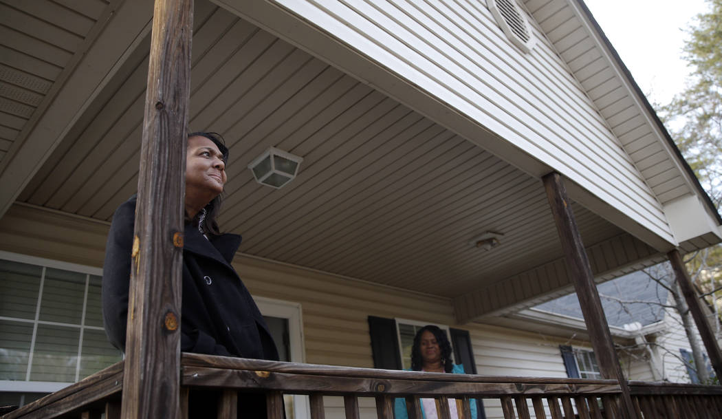 In this Jan. 6, 2016, file photo, Deann Watson, mother of Clemson quarterback Deshaun Watson, poses portrait on the front porch of her home in Gainesvilles, Ga. (AP Photo/John Bazemore, File)