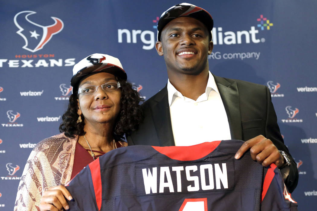 In this April 28, 2017, file photo, Houston Texans quarterback Deshaun Watson, right, poses with his mother Deann after an NFL football news conference in Houston. (AP Photo/David J. Phillip, File)